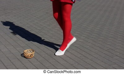 Girl in red stockings curtseying - Isolated shot of a young...