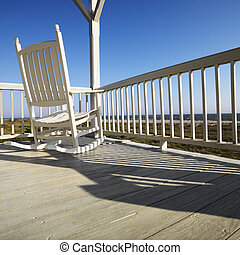 Rocking chair on porch - Rocking chair on porch with railing...