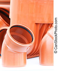 orange pieces- drain pipes pvc on white background - orange...