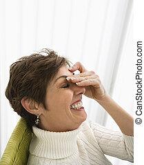 Woman laughing.