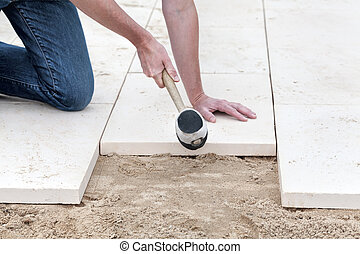 Installing new pavement - Installing new slabs in garden as...