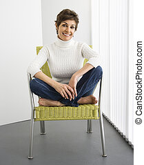 Woman smiling - Portrait of pretty woman smiling sitting on...