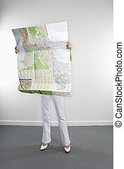 Woman reading map - Full length portrait of Caucasian woman...