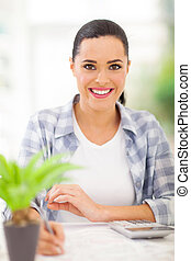 young woman doing home finances