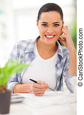 young woman planning retirement investment - portrait of...