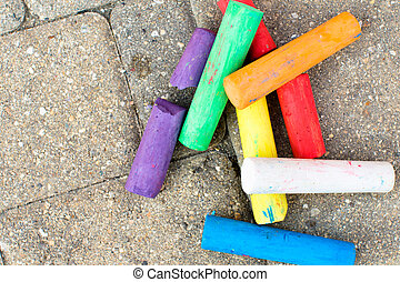 Colorful Chalks On the Paver Streets - Colorful chalks...