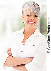middle aged woman with arms folded