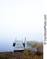 empty jetty in foggy river - wooden empty jetty in foggy...