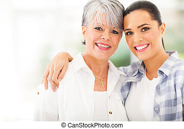 mature mother and young daughter portrait - portrait of...