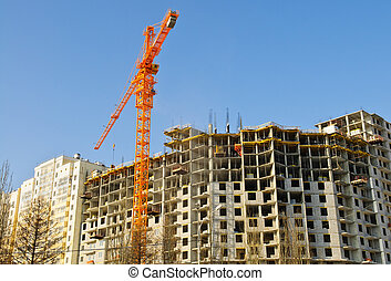construction crane and building over blue sky