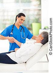 female doctor handshaking with patient - female doctor...
