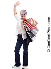 middle aged shopper waving goodbye - happy middle aged...