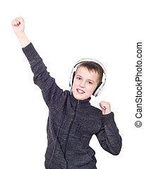 Close up portrait of boy listening to music with headphones