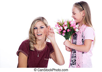 daughter gives flowers for mothers