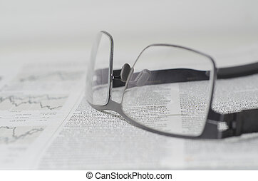 Financial newspaper and eyeglasses