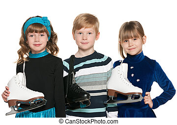 Children with skates - Three smiling children with skates on...