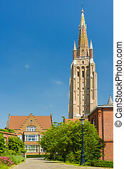 Our Lady Church in Bruges in a summer day - The Our Lady...