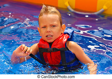 Kid in vest at the pool water park