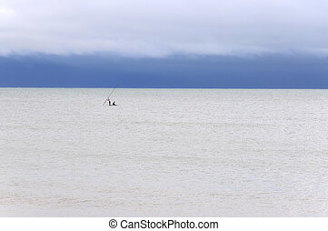 Pititinga (RN, Brazil) Raft and fishers on the sea - Cloudy...