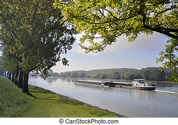 Barge on the Danube river, in Bavaria (Germany) at late...