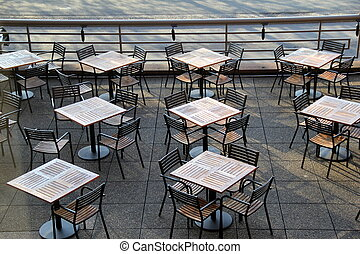 Several empty tables on patio