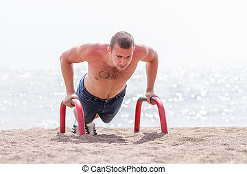 Guy pushing up outdoors