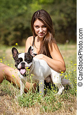 Pretty young girl with her dog