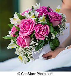 Bride holding a wedding bouquet - Bride holding beautiful...