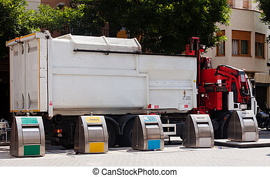 Recycling truck picking up bin - Recycling truck picking up...
