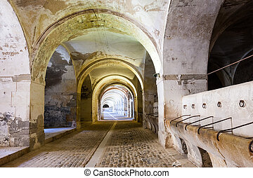 Stables in the dungeon of the abandoned castle in Figueres,...