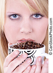 woman has coffee beans in cup