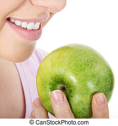 Woman with apple and white teeth
