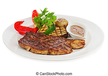 Grilled steaks, baked potatoes and vegetables on white plate.