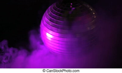 Disco ball in smoky purple light - Round mirrored silver...