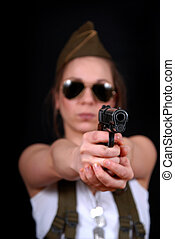 a young girl with gun