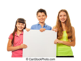 Kids with advertising - Three happy smiling friends, two...