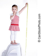 child with measuring tape
