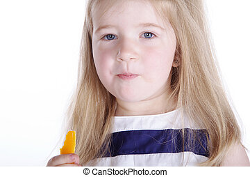 Little girl nibbling candy