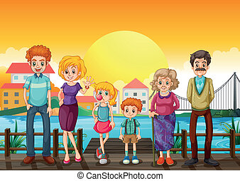A family at the wooden bridge across the village -...