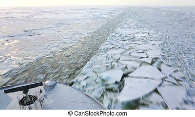 Ice flakes - Ship heading through a frozen Baltic sea