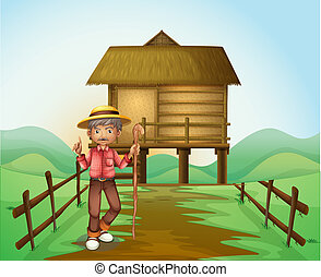 An old man with a cane standing in front of the nipa hut -...