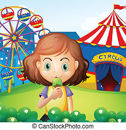 A girl at the carnival eating an icecream - Illustration of...