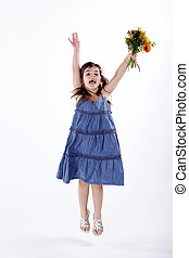 girl with bouquet jumping for joy
