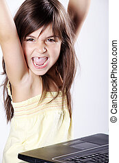 girl rejoices at the laptop