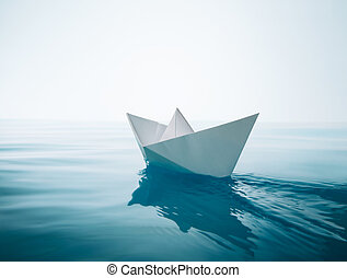 paper boat sailing on water causing waves and ripples