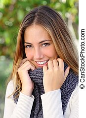 Close up of a beautiful woman smiling in winter - Close up...