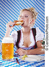 Bavarian woman eating pretzel