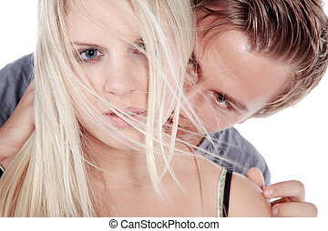 man kissing woman in the neck