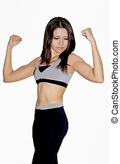 Female fitness instructor is flexing her muscles. She is...