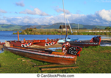 Maori boats - Traditional Maori wood carved canoes on the...